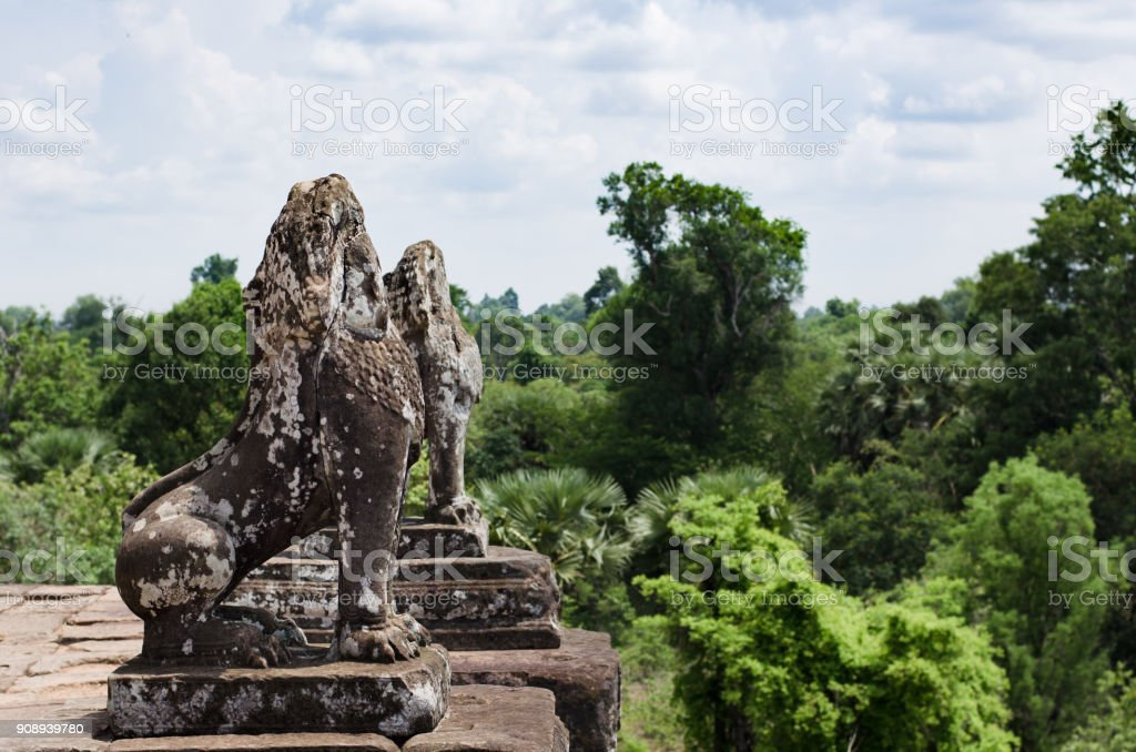 Two stone lions guarding Pre Rup temple terrace in Angkor Wat stock photo