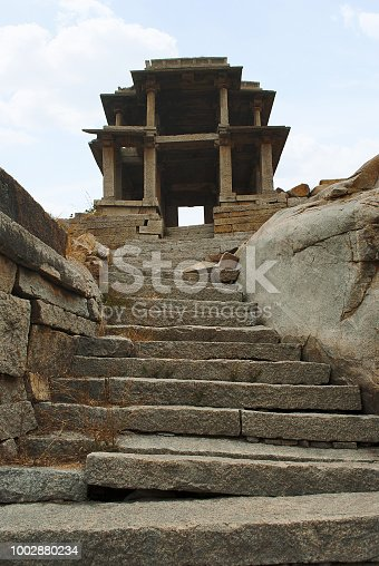 istock Two storied gateway behind Narasimha Temple. Hampi, Karnataka, India. 1002880234