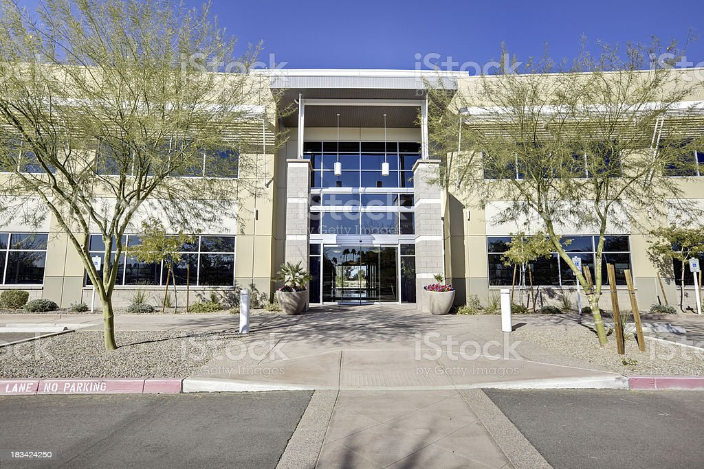 Two story office building against blue sky stock photo