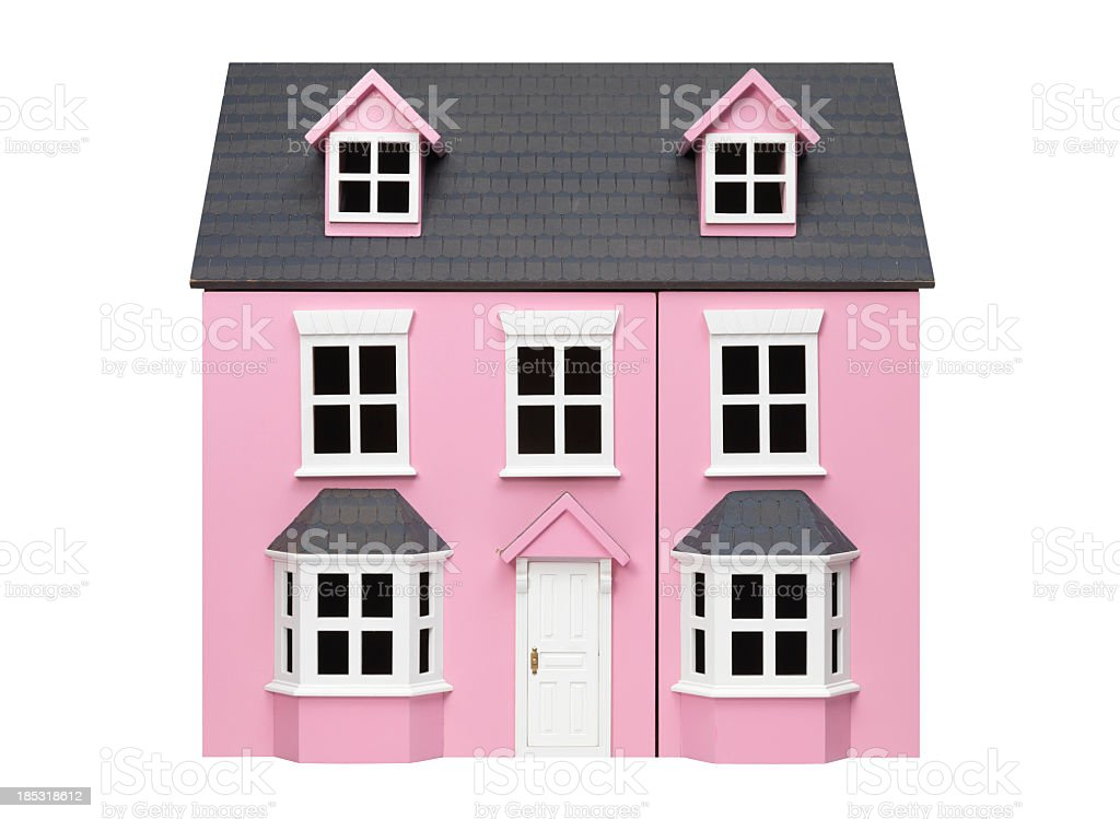 Two story pink model play house with white trim and door stock photo