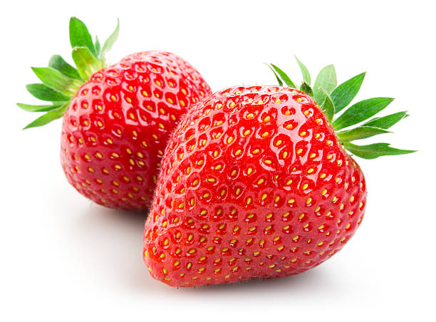 two strawberries isolated on white background - cut out stok fotoğraflar ve resimler