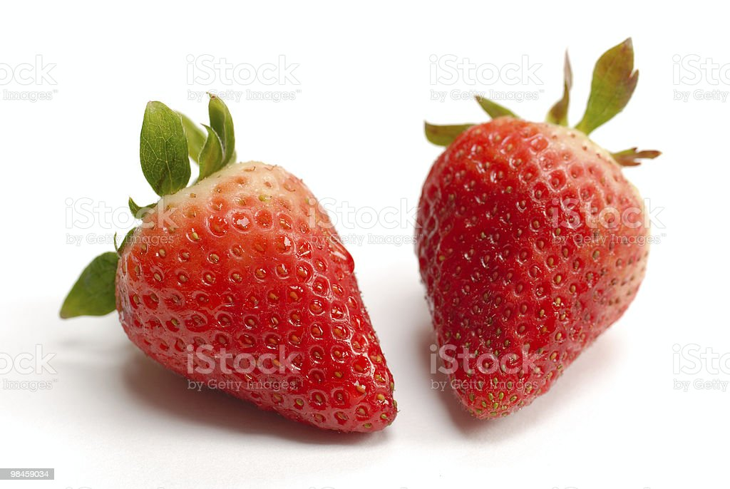 Two strawberries isolated on white background royalty-free stock photo