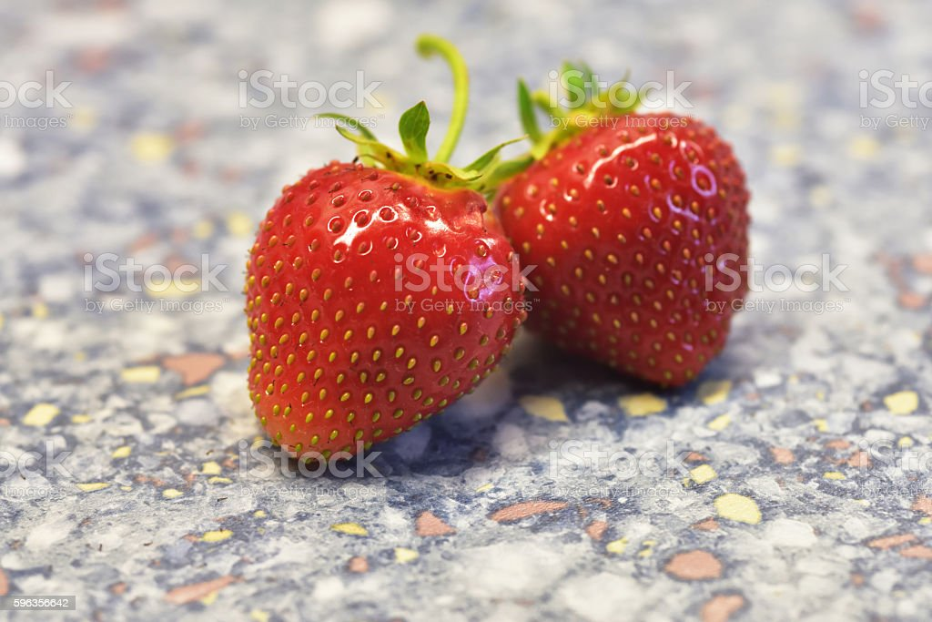Two Strawberries on a table royalty-free stock photo