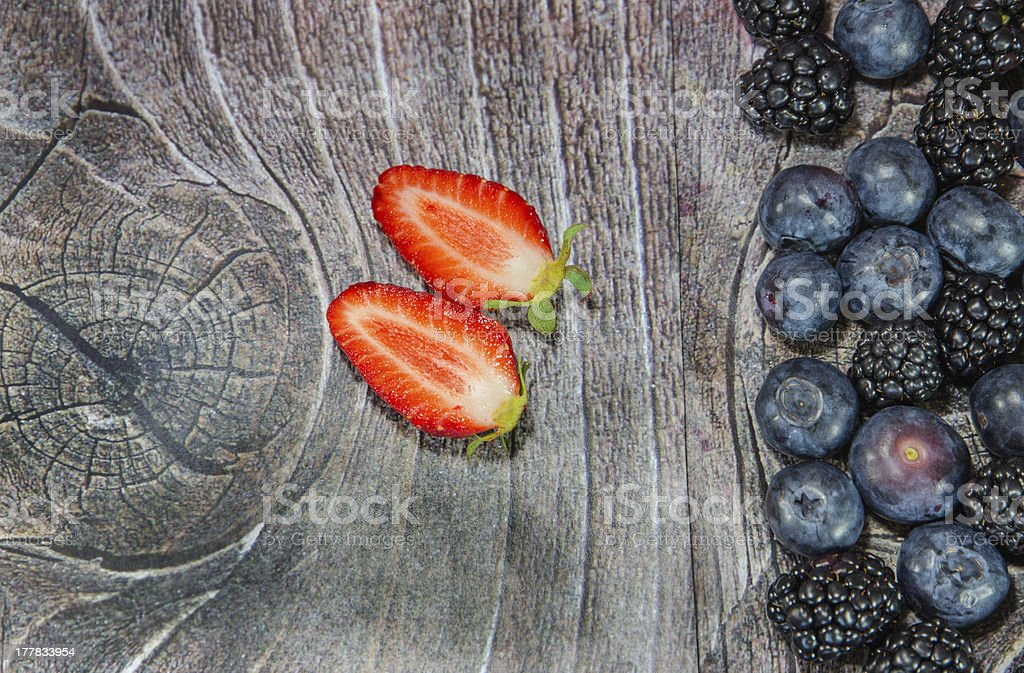 Two strawberries sliced with blueberries royalty-free stock photo
