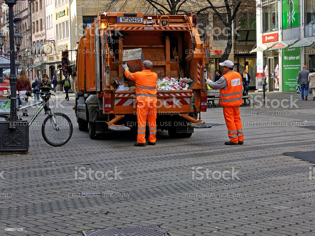 two street cleaners at work stock photo