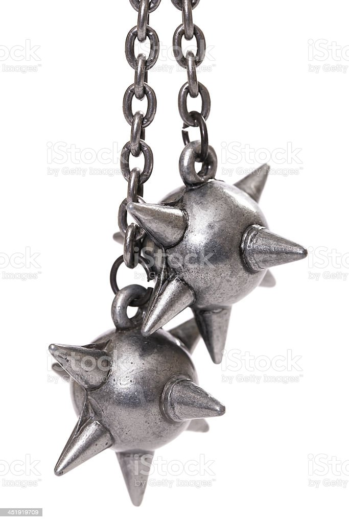 Two striking heads of flail stock photo