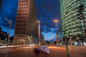 istock Two striking modern towers rise over city street at night 1344153450