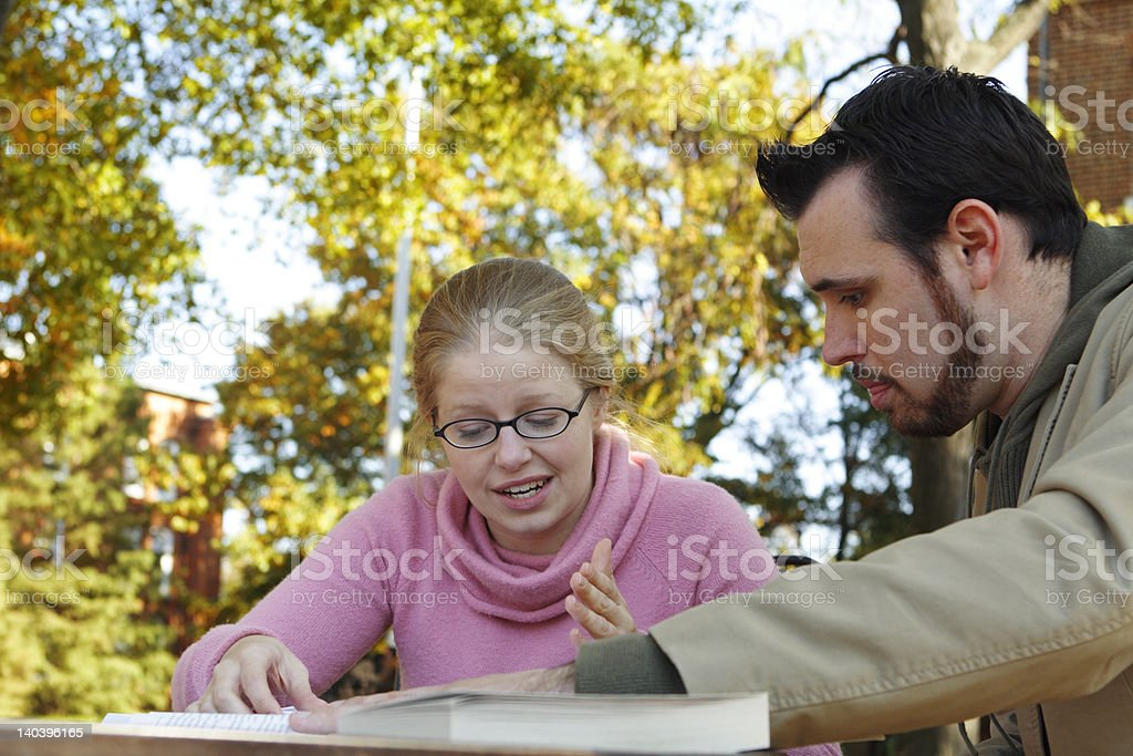 Two Students Discussing Sitting Outside Studying royalty-free stock photo