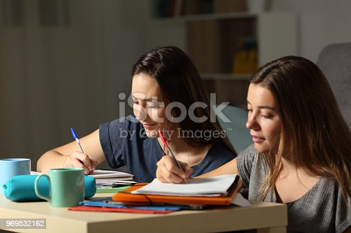 820495452 istock photo Two students doing homework together 969532162