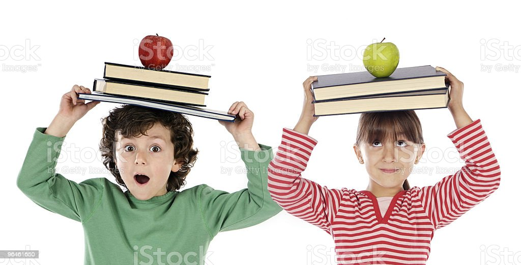 Two students doing little to balance royalty-free stock photo