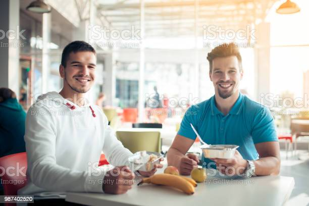 Two students have dinner in cafe with healthy food picture id987402520?b=1&k=6&m=987402520&s=612x612&h=0xpgkeomjmwn7hvmtbvevxgr0liwdutlc2cwnkoysyg=