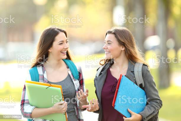 Two students talking walking in the street picture id1055139804?b=1&k=6&m=1055139804&s=612x612&h=iw2o1bvip7m0mcblweaoul9 vmnvw emvcldai0np8c=