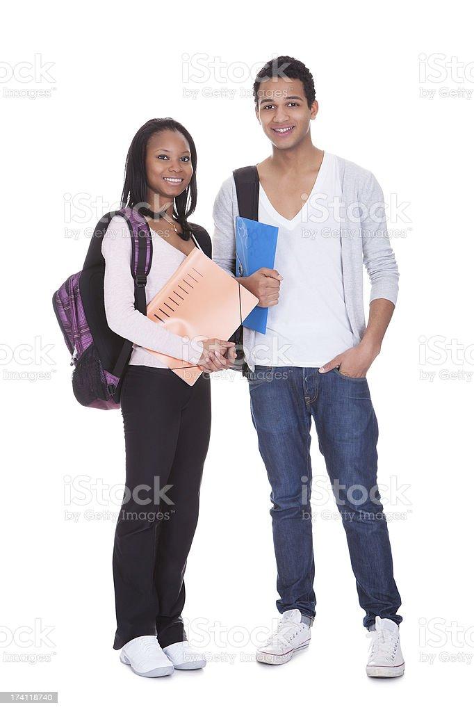 Dois alunos com pasta e mochilas - foto de acervo