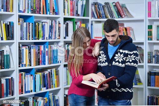 834814926 istock photo Two students working together in a library 987990180