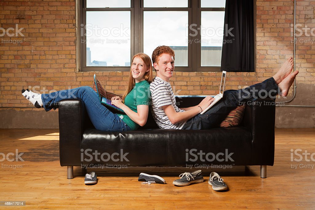 Phenomenal Two Students Working Together In Sofa Couch Stock Photo Inzonedesignstudio Interior Chair Design Inzonedesignstudiocom