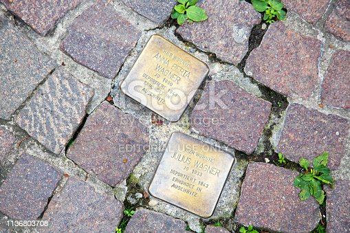 Aschaffenburg / Germany - June 2018. Stolperstein or stumbling stone by Gunter Demnig in Aschaffenburg. Two cobblestones remembering the victims of the deportation and killing by the Nazis during the second world war.