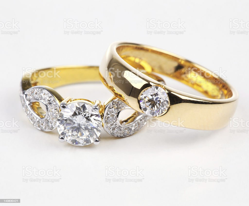 Two styles of golden ring with diamond. royalty-free stock photo