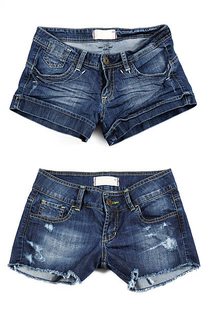 two styles of women's jean shorts - jean shorts stock photos and pictures
