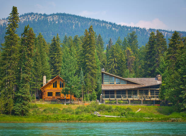 Two styles of wooden house commonly found near lakes and rivers. Rocky mountain ( Canadian Rockies ). Portrait, fine art. Near Calgary. Jasper and Banff National Park, Alberta, Canada: August 2, 2018 stock photo
