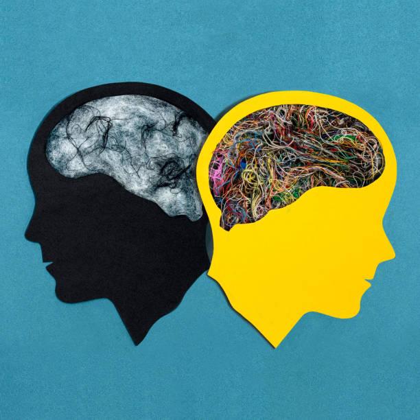 Two stylized head silhouettes. Bipolar disorder stock photo