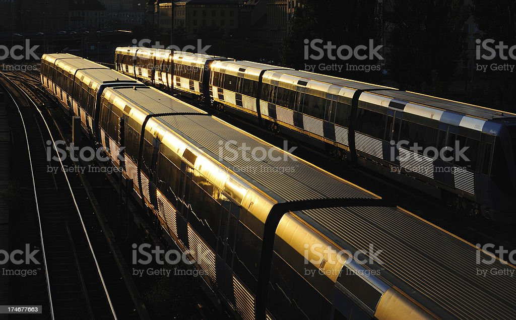 Two subway trains into the sunset royalty-free stock photo