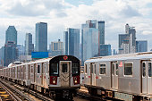 istock Two Subway Trains Speeding on Elevated Track in Queens, New York 1256195507