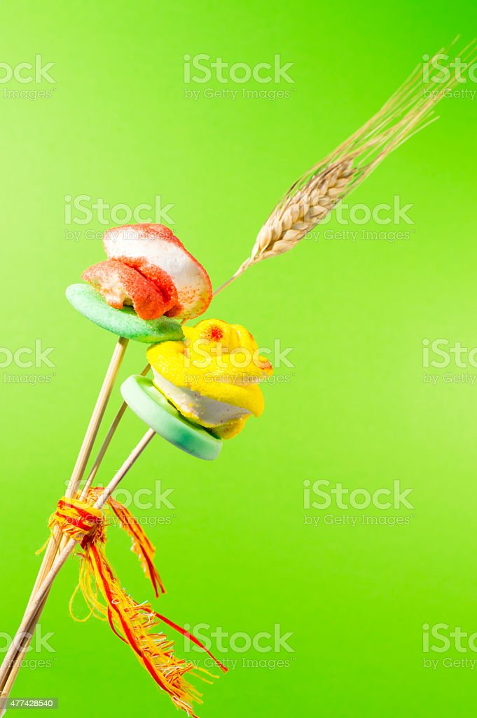 two sugar roses and ear of wheat stock photo