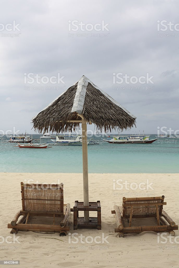Two sunbed on the beach royalty-free stock photo