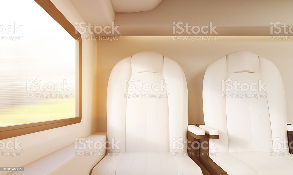 Two sunlit white chairs in compartment stock photo