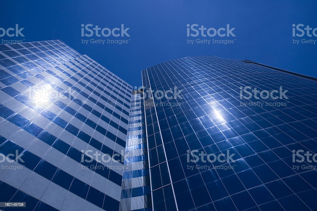 Two suns reflected in buildings royalty-free stock photo