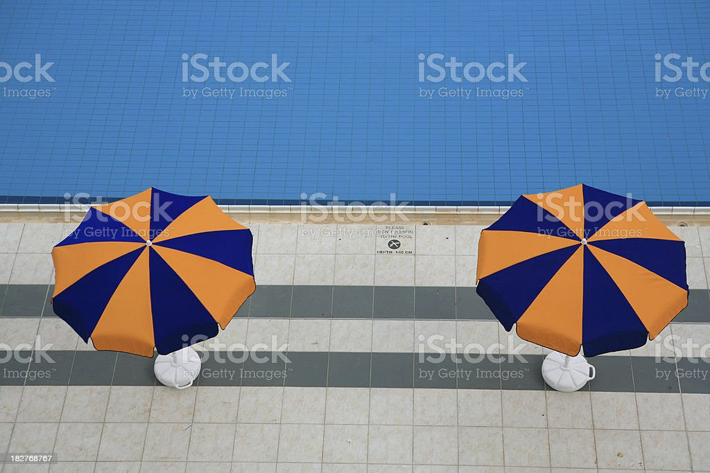 Two Sunshades Along the Pool stock photo