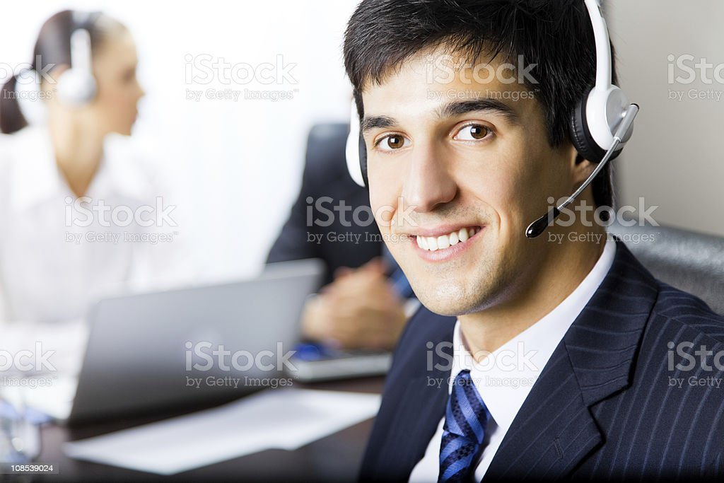 Two support phone operators at workplace royalty-free stock photo