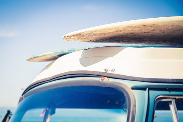 Two surfboards on top of a car  stock photo