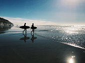 Two surfers at a beach in San Diego, California