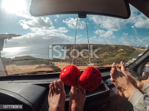 Two surfers resting in the van