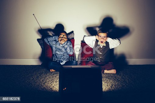 istock Two Surprised Young Nerds Watching Vulgar Television Show 655182378