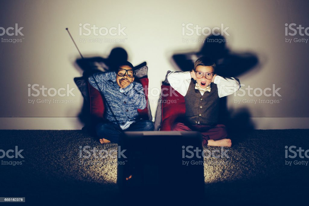 Two Surprised Young Nerds Watching Vulgar Television Show stock photo