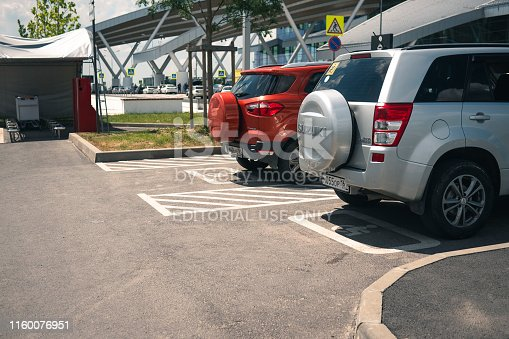 istock two SUVs are parked on the ground for the disabled. 1160076951