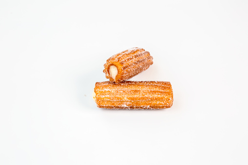 two sweet cream stuffed fritter churros with white background