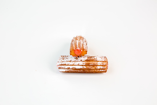 two sweet strawberry fritter churros with white background