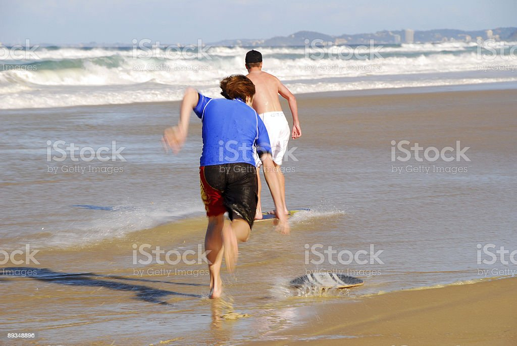 Two swimmers on Beach royalty-free stock photo