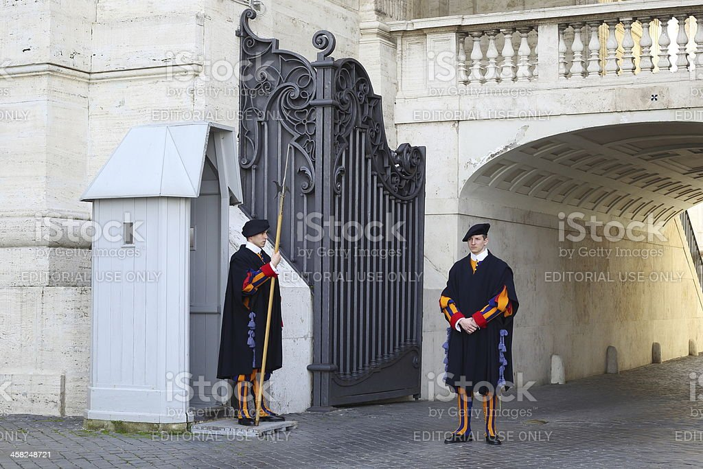 Two Swiss guard stands at an entrance of the Vatican royalty-free stock photo
