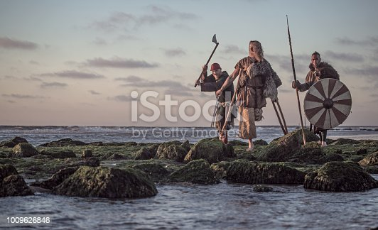 istock Two sword wielding bloody medieval warriors together on a cold seashore 1009626846