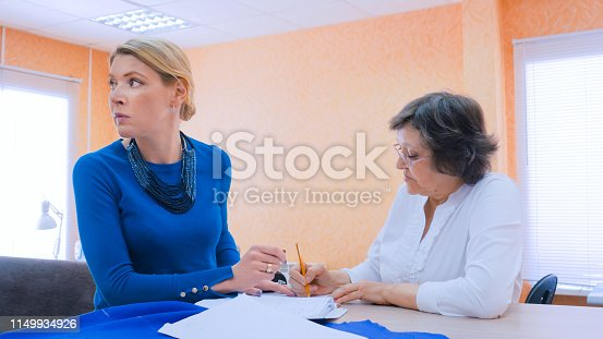 istock Two tailors discussing new couture collection 1149934926