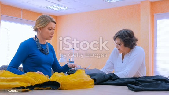 istock Two tailors discussing new couture collection 1220365312