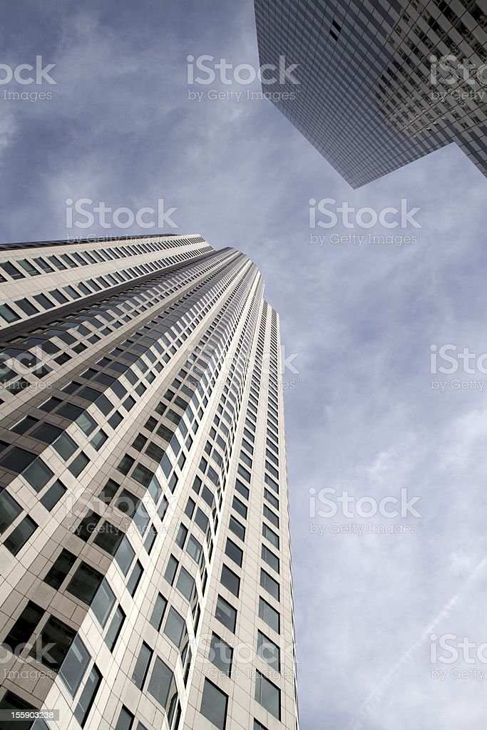 Two Tall Skyscrapers Beneath Cloudy Sky royalty-free stock photo