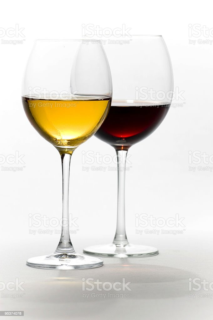 Two tall wine glasses isolated on white stock photo