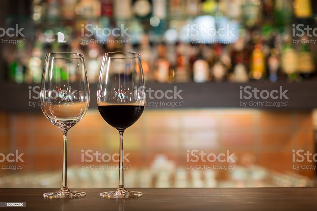 Two tall wine glasses stock photo