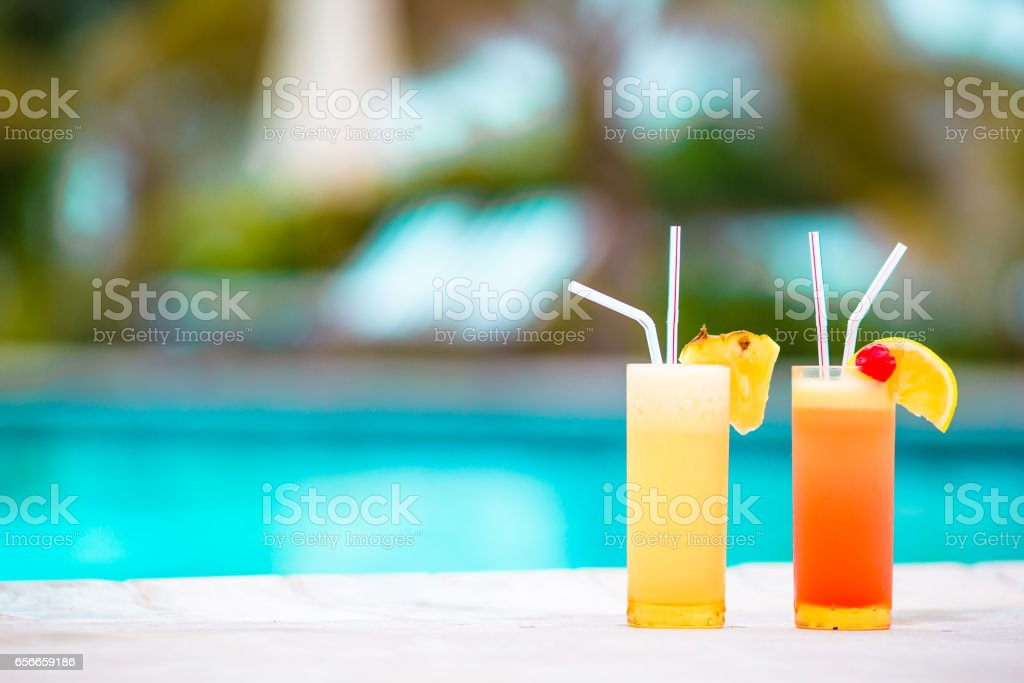 Two tasty cocktails on tropical white beach stock photo
