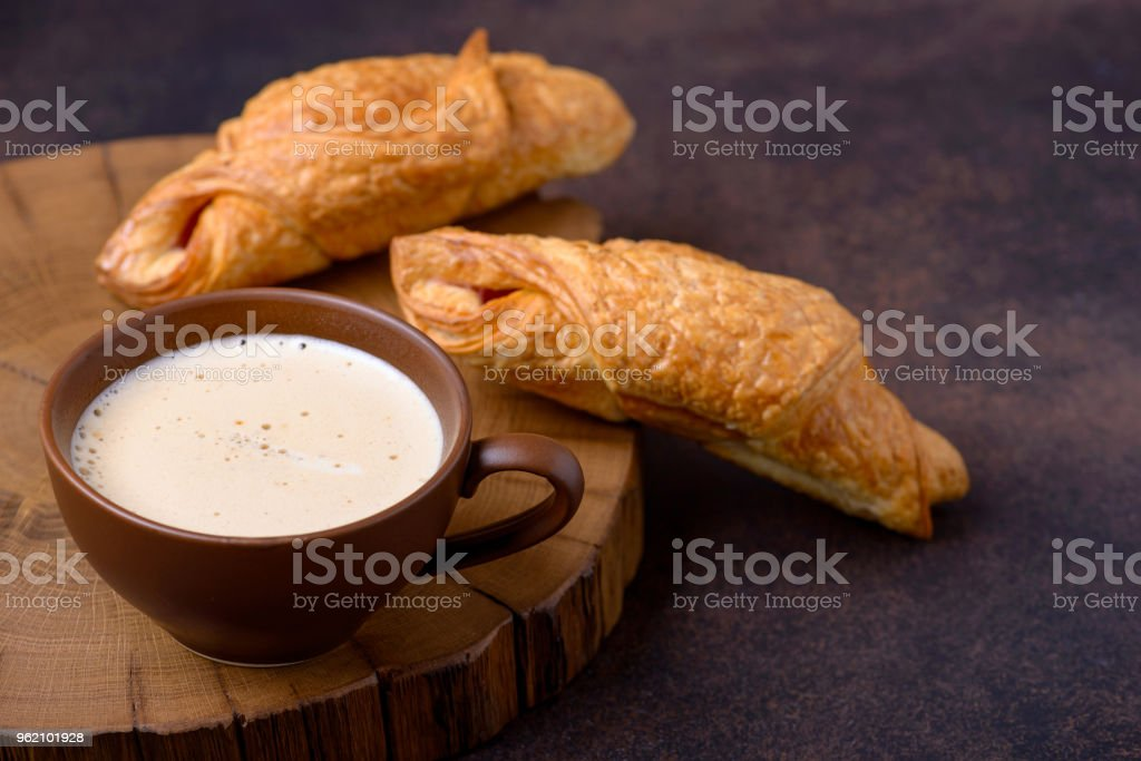 Two tasty croissants and coffee cup stock photo
